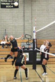 Woodland's Tayler Boncal goes for the kill Oct. 5 versus Naugatuck in Beacon Falls. The Hawks won the match in three sets (25-17, 25-21, 25-20). –ELIO GUGLIOTTI