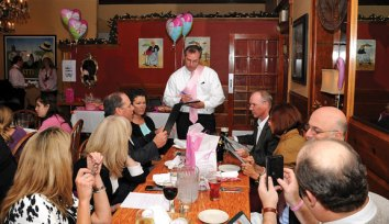 Bill Calderara, President and CEO at Naugatuck Valley Savings and Loan, takes orders during the Waiters Go Pink event at Jesse Camille's Restaurant in Naugatuck Oct. 25. The event was part of Griffin Hospital's Valley Goes Pink initiative and raised money for the hospital's Hewitt Center for Breast Wellness. –LUKE MARSHALL