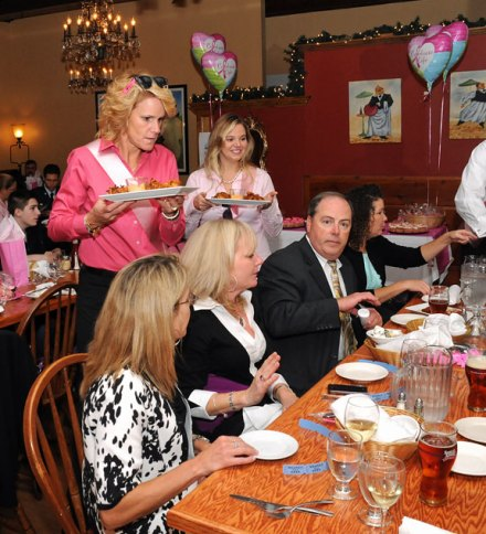 Naugatuck Deputy Mayor Tamath Rossi, left, and attorney Beth Grassette of the Penner Law Firm serve food to guests during the Waiters Go Pink event at Jesse Camille's Restaurant in Naugatuck Oct. 25. The event was part of Griffin Hospital's Valley Goes Pink initiative and raised money for the hospital's Hewitt Center for Breast Wellness. –LUKE MARSHALL