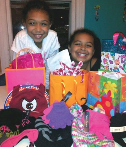 Shayla Shaw of Naugatuck celebrated her eighth birthday Nov. 17 at Kids Create in Naugatuck. Instead of gifts, Shaw asked her Maple Hill School classmates to bring hats, gloves, and scarves for the Naugatuck food bank. Shaw collected 19 scarves, 35 hats and 45 pairs of gloves. Shaw also donated $20 that she received in a birthday card to the food bank as well. Pictured, Shayla Shaw, left, with her sister Kamiana Shaw. –CONTRIBUTED