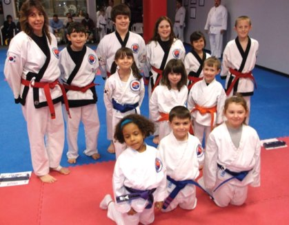 The Kid Kicks program at USA Martial Arts in Naugatuck held a karate grading Nov. 26 The students demonstrated skills in sparring, forms, kicking, board breaking, rolls and break falls. Pictured, first row, Sabrina DaSilva, Nico Albanese, and Nina Peterson. Second row, Emily Labracque, Shayla Cummings, and Ean Rupwani. Third row, Liz Recce, Justin Oliver, Noah Oliver, Karli Butcher, Lauren Mulinski, and Nathaniel Smith. -CONTRIBUTED