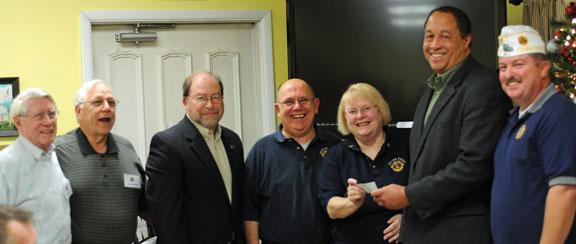 American Legion Post 25 made a $140 donation to the Beacon Falls flag fun, which pays for American flags along the streetscape, during the Post's December meeting. The fund is managed by the Beacon Falls Lions Club. Pictured, from left Lions Club and American Legion member Jim Woodward, Lion Joe Poirier, Lion and Town Treasurer Mike Krenesky, Lion William Unfricht, Lion Club President Mary Unfricht, First Selectman Gerard Smith and American Legion Post 25 Commander Bruce Carlson. –LUKE MARSHALL