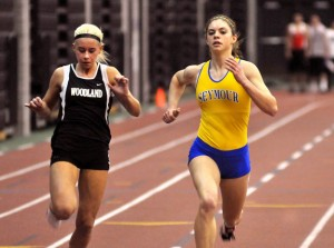 Woodland's Tayler Boncal, left, finishes second behind Seymour's Katie Petroski in the girls 55m during last year's NVL Indoor Track and Field Championships at the Floyd Little Athletic Center at Hillhouse High School in New Haven. The Woodland boys and girls teams won the meet last year and will look to defend their titles on Tuesday. –RA ARCHIVE