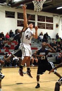 Naugatuck's Brandon Kuczenski puts up a shot against Ansonia Friday in Naugatuck. Kuczenski scored a game-high 24 points and added 10 rebounds and two blocks as Naugatuck won, 60-54. –KEN MORSE