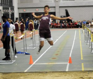 Naugatuck High School's Isaque Monterio competes in the long jump Tuesday at the Naugatuck Valley League indoor track championships in New Haven. The Naugatuck boys team won the championship as the girls came in third. –LUKE MARSHALL