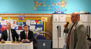 Naugatuck High School's new head football coach Craig Bruno, right, addresses the Board of Education Feb. 14 as board members, Scott Slauson, left, and Mayor Robert Mezzo listen. -LUKE MARSHALL
