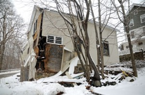 This detached garage behind 122 Aetna St. was taken down Monday because it appeared in danger of collapsing into Edward Street. –FILE PHOTO