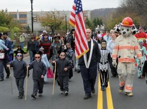 Naugatuck firefighter John DeBisschop leads the Naugatuck Fire Department's annual Halloween parade down Old Firehouse Road last October. DeBisschop is this year's Firefighter of the Year. –FILE PHOTO