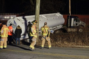 Naugatuck firefighters respond to an accident that left a Coastal Carriers truck stuck in a ditch Thursday night at the intersection of Neumann Street and Rubber Avenue Extension. –RA ARCHIVE