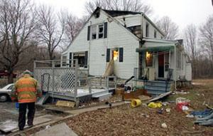 Fire investigators on scene Friday at a fire at 122 Waterbury Road in Prospect. –REPUBLICAN AMERICAN