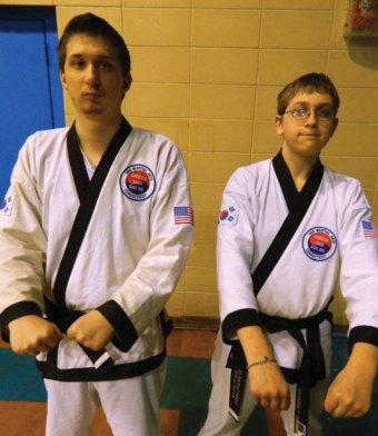 Robert Vidler and Raymond Mercure from USA Martial Arts in Naugatuck were promoted to 2nd Dan Black Belt at a grading held on Feb. 22 at the Boys Club in Waterbury. -CONTRIBUTED