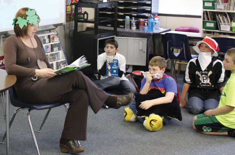 Local schools celebrated Read Across America March 1 in honor of Dr. Seuss' birthday, which was March 2, with guest readers, dressing up and reading their favorite books. Annette Hart, a fifth-grade teacher at Community School in Prospect, reads 'The Giving Tree,' by Shel Silverstein to her class dressed as a giving tree. –ELIO GUGLIOTTI