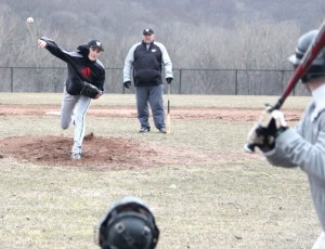 Woodland's Everett Miner pitches as head coach Mike Kingsley looks on during practice Monday at the school in Beacon Falls. Woodland is looking to rebound from a 7-13 season last year. –ELIO GUGLIOTTI