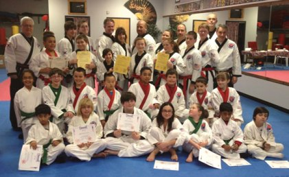 USA Martial Arts in Naugatuck held a junior advanced karate grading on March 21. Students demonstrated skills in sparring, forms, board breaking, Asian weapons, rolls and break falls. Four members were invited to grade to 1st Dan Black Belt on Sept. 13. Pictured, first row sitting, Deepak Prakash, Anna Demagistris, Connor Reese, Kylie Ramponi, Natalia Lizak, David Marimekala and Aidan Lyons all promoted at the green belt level. Second row kneeling, Hansuja Chaurasia and Joe Constantino to Apprentice red nelt; Christian Giordano, Evin Lin, Isaiah Shea, Andrew Hopkinson, Nate Dimatteo and Kathleen Robinson all promoted at red belt level. Third row standing, Jonathan Velasquez to Apprentice Black Belt; Nicky Mercure, Lauren Mulinski, Nathaniel Smith, Karli Butcher were all invited to grade to 1st Dan Black Belt, Noah Santoro, Emil Lizal and Master Antonucci. Fourth row, Grand Master Cheezic, Eric Wrogg, Ray Mercure, Dennis Buckley, Liz Recce, Anthony Oliver, Misty Sherman, Pete Meleschnig and Doug Wilke.-CONTRIBUTED