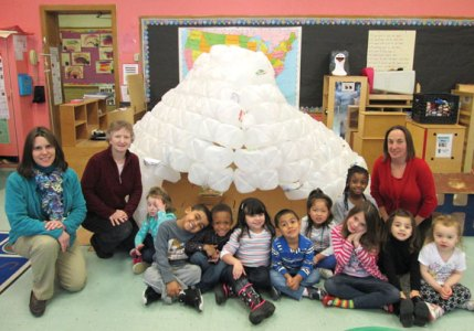 Children in the School Readiness Class II at Central Avenue Preschool where recently taught a lesson about what life is like in very cold places. As part of the lesson, teachers discussed the different types of home structures found in cold climates and the children built an igloo out empty milk and juice gallon-size jugs while learning about recycling. The children, staff, parents, family and friends were asked to donate empty milk and juice gallon-size jugs. In total, 422 jugs were collected and structure began in January with completion in early March. During the building and collecting process, the children learned how to estimate and graph the number of jugs collected. Pictured, from left, teacher Laurie Deoss, Naugatuck Recycling Coordinator Sheila Baummer, children of the School Readiness II classroom and teacher Lisa Phillips of Central Avenue Preschool. -CONTRIBUTED