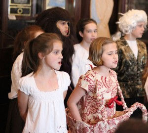 Members of the Western Elementary School Theater Club perform a scene from 'Beauty and the Beast' April 11 during a grant reception at the Naugatuck Historical Society Museum. The club received a $500 grant last year from the Naugatuck Education Foundation. –ELIO GUGLIOTTI