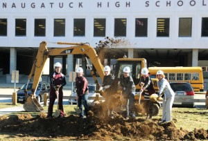 Naugatuck High School Principal Janice Saam, right, with five of her students throw shovels of dirt during a groundbreaking ceremony Tuesday morning at the school to mark the start of the $81 million renovation project. –LUKE MARSHALL