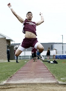 """Naugatuck's Isaque Monteiro jumps 17' 5"""" in the long jump during a tri-meet against Watertown and Wilby at Watertown High School Tuesday afternoon. –RA ARCHIVE"""