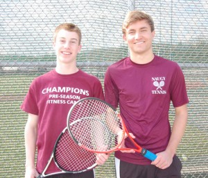Naugatuck High boys tennis captain Jake Morrissey, a junior, left, and Julian Milek, a senior exchange student from Germany, will lead the Greyhounds on the tennis court this season. –KEN MORSE