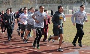 The Naugatuck High boys track team runs laps at the school during practice late last month. –LUKE MARSHALL