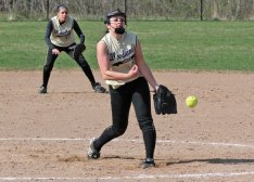 Woodland's Samantha Lee (8) fires a pitch as Brooke Leshin (10) digs in at second base Monday versus Naugatuck in Beacon Falls. The Hawks rallied to win the game, 5-4, in eight innings. –ELIO GUGLIOTTI