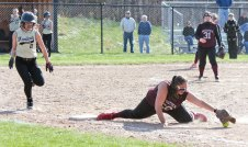 Naugatuck's Sydney Cotto (50) stretches for the ball and an out as Woodland's Rachel Starkey (2) races down the first base line Monday afternoon in Beacon Falls. The Hawks rallied to win the game, 5-4, in eight innings. –ELIO GUGLIOTTI