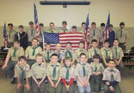 Members of Prospect Boy Scout Troop 258 display several of the American Flags they recently prepared to display throughout town. In April nearly 30 members of Prospect Troop 258 spent an evening preparing over 80 American flags for display along Prospect's main roads. The boys attached flags to poles, gluing clips and adding reinforcing cable ties to help the flags stay flying in the heavy winds throughout town. The American flags are funded through the Prospect Flag Fund, established last year by resident Robert Hiscox. The scouts, along with the help of Ed Bashe of Ed the Tree Man, and Jack Geary and Paul Ricchezza of Cutting Edge Signs and Shirts helped maintain and display over 100 flags throughout town last year. These same people will be working to get the flags out again prior to this year's Memorial Day Parade. Joe Longo III, a senior from Sacred Heart High School in Waterbury, put up over 80 of the flags May 3 as part of his community service project graduation requirements. He was assisted with a bucket truck from J and T Electrical Contractors of Waterbury. The flags honoring all members of our military past and present will be displayed throughout the spring and summer months. Donations to the Prospect Flag Fund may be sent directly to Town Hall where a separate account is maintained to replace flags and upgrade the display. –CONTRIBUTED