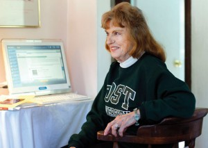 Charlotte Butler sits at her computer where she's been taking online courses at Post University. The 80-year-old Naugatuck resident hopes by going back to school, she will inspire her sons to get their college degrees. –RA ARCHIVE