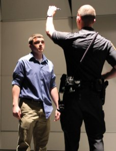 Naugatuck High School senior Austin Wagner is given a mock sobriety test by Naugatuck High School Resource Officer Marc Robinson during a senior assembly hosted by the student council May 24 at the school. The senior prom was the same day and the assembly was held to remind students how quickly life can change in an instant when a bad decision, like driving drunk, is made. 'It is to encourage all of you to make healthy choices and stay safe,' Principal Janie Saam told the seniors gathered in the auditorium. Due to rain, a mock crash planned for the day was canceled. So, the council made a video depicting a crash and the consequences from driving drunk to show to their peers. –ELIO GUGLIOTTI