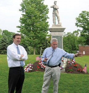 Prospect Mayor Robert Chatfield, right, talks about the history of Prospect with U.S. Sen. Chris Murphy (D-Conn.) on the Town Green Wednesday afternoon. Murphy is planning to visit every town in the state, a tour that started with Prospect. –LUKE MARSHALL