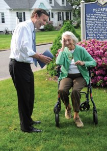 U.S. Sen. Chris Murphy (D-Conn.), left, honors Shirley Sabo of Prospect for her years of service to the Democratic party Wednesday afternoon on the Town Green. –LUKE MARSHALL