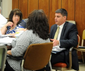 Naugatuck Mayor Robert Mezzo, right, discusses the budget Thursday night as Board of Finance Chairman Diane Scinto, left listens. The Joint Boards of Mayor and Burgesses and Finance adopted a $110.9 million budget for the 2013-14 fiscal year.