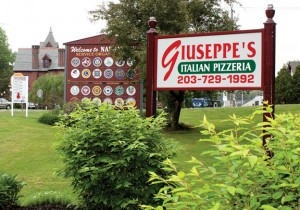 A sign for Giuseppe's Italian Pizzeria in Naugatuck, which ignited a controversy and a review of sign regulations in the borough, was supposed to be taken down by the end of next month but the pizzeria owners have filed an appeal. –RA ARCHIVE