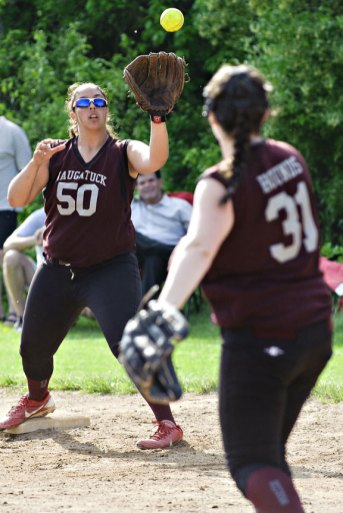 Naugatuck first baseman Sydney Cotto (50) prepares to make the catch from pitcher Nina Kosciuszek for an out Monday afternoon versus Holy Cross during the quarterfinals of the NVL softball tournament in Waterbury. The Greyhounds fell to the Crusaders, 8-3. –RA ARCHIVE