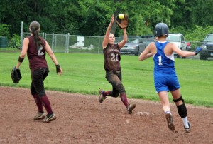 Naugatuck's Sarah Chandler (21) hauls in the toss from second baseman Erica Bohuski (2) to get the force out at second on Hall's Lianna Pevar (1) Tuesday afternoon during the first round of the Class LL softball tournament at Breen Field in Naugatuck. The Greyhounds won, 4-1. –ELIO GUGLIOTTI