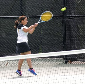 Woodland's Salma Shitia warms up before her match with Seymour's Olivia Tabaka Tuesday afternoon in Beacon Falls. The Hawks won the match, 4-3, and earned the No. 1 seed in the Naugatuck Valley League tournament. –LUKE MARSHALL