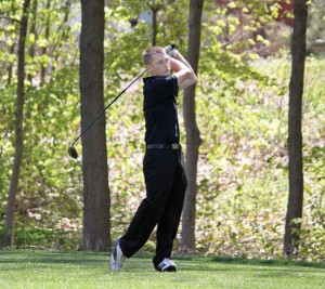 Woodland's Mike Classey holds form as he watches his tee shot on the first hole against Naugatuck Monday afternoon at Hop Brook Golf Course in Naugatuck. Classey shot a 49 on the day as the Hawks fell to the Greyhounds, 171-188. –ELIO GUGLIOTTI