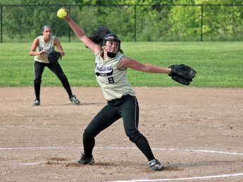 Woodland's Samantha Lee (8) delivers a pitch as Brooke Leshin settles in at second base Monday afternoon during the quarterfinals of the NVL softball tournament versus Wolcott in Beacon Falls. Woodland won, 9-0, but fell Tuesday in the semifinals to Seymour, 11-1. –ELIO GUGLIOTTI
