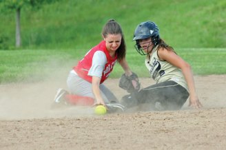 Woodland's Samantha White slides safely into second as Wolcott's Rene Miller can't haul in the throw Monday afternoon during the quarterfinals of the NVL softball tournament in Beacon Falls. Woodland won, 9-0, but fell Tuesday in the semifinals to Seymour, 11-1. –ELIO GUGLIOTTI
