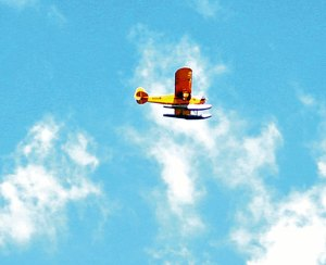 A seaplane flies over downtown Beacon Falls during the Naugatuck River Festival May 4. The town is exploring the idea of establishing a seaplane base at Toby's Pond. –FILE PHOTO
