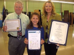 Algonquin School third-grader Samantha Ann Strell, 9, of Prospect, center, was honored May 20 at the school by Prospect Mayor Robert Chatfield, left, and state Rep. Lezlye Zupkus (R-89) for winning the CHET Dream Big Competition for New Haven County. The competition, open to Connecticut students in grades kindergarten through fifth, is a drawing and essay contest in which students tell what they dream of doing after college. Strell was chosen for her drawing entry out of 2,200 applicants and is one of 93 students from across the state selected. Strell was presented with her award May 16 at Rentschler Field in East Hartford. Winners were each awarded a $300 CHET direct-sold 529 college savings account. -CONTRIBUTED