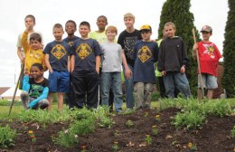 Cub Scouts with Pack 27 from Prospect pose for a picture after planting flowers in front of the old firehouse May 18. The scouts slept out on the Town Green May 17 and planted the flowers when they woke up. The scouts were thanked by Mayor Robert Chatfield for their hard work. They also made a float for the Prospect Memorial Day parade and rode it in pride in support of veterans. -CONTRIBUTED