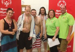 Sue and Carl LaFevre, right, of Thurston Energy in Naugatuck volunteered at a recent Special Olympics Connecticut Northwest Regional swim meet held at Oxford High School. Thurston Energy was a Silver Sponsor of the Regional Games. With the LaFevres is the Special Olympics Waterbury Unified Relay Team. From left, unified partner Robyn Hicock, athletes Travis Marrero and Robert McDermott and unified partner Vincent Marrero. -CONTRIBUTED