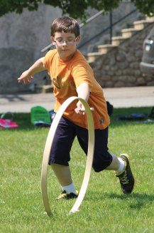 Algonquin School third-grader Nathan Pepin plays hoop and stick on the Town Green May 30. Third-graders from the school in Prospect stepped back in time to learn about the town and its history. The students toured Town Hall, Prospect Cemetery, the Center One schoolhouse and the Hotchkiss House and barn. As part of the day, students wrote with quill pens and played games from yesteryear. The program was organized by third-grade teachers Marcia Beltrami, Elena Guerra and Kathleen Bicio and the Prospect Historical Society. The program was funded through the Region 16 innovative grant initiative. The program ties into the state's social studies standards and the students will be creating a history book about Prospect for children. –ELIO GUGLIOTTI
