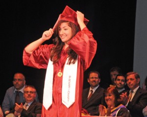 Naugatuck High School Class of 2013 president Melina Dezhbod leads her fellow graduates in the turning of their tassels June 24 at the Palace Theater in Waterbury. Next year's ceremony is likely to be held at the theater again due to ongoing renovations at the school. –FILE PHOTO
