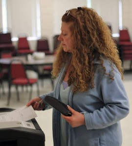 Shelley Zinno of Prospect casts her ballot on the budget Monday afternoon at the firehouse. The proposed $7.28 million 2013-14 town budget was approved by 62 votes, 660 yes to 598 no. –ELIO GUGLIOTTI