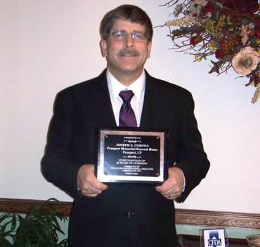 Joseph Corona, owner and funeral director of Prospect Memorial Funeral Home, was recognized at the summer meeting of the Connecticut Funeral Directors Association for his dedicated service as a licensed funeral director in Connecticut for 26 years. Corona said he has been honored to serve families in Prospect, Naugatuck and surrounding communities throughout this time while working at Buckmiller Brothers Funeral Homes and now as an owner of Prospect Memorial Funeral Home. –CONTRIBUTED