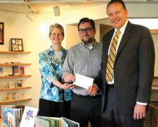 """The Naugatuck Savings Bank Foundation recently awarded a $500 grant to the Whittemore Memorial Library to help fund the upgrade of its children's nonfiction book collection for grades kindergarten through six. 'We are thankful for the Naugatuck Savings Bank Foundation's support,"""" said Library Director Jocelyn Miller. 'Its contributions such as this that help the library continue to thrive.' Pictured, from left, Miller, Library Youth Services Department Head Matthew Yanarella and President and CEO of Naugatuck Savings Bank Charles Boulier III. –CONTRIBUTED"""