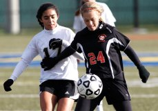 Woodland's Alexa Casimiro, left, tries to get to the ball controlled by Watertown's Erin Montambault during the NVL championship game at Municipal Stadium in Waterbury. Watertown took home the victory, winning 2-0. –RA ARCHIVE