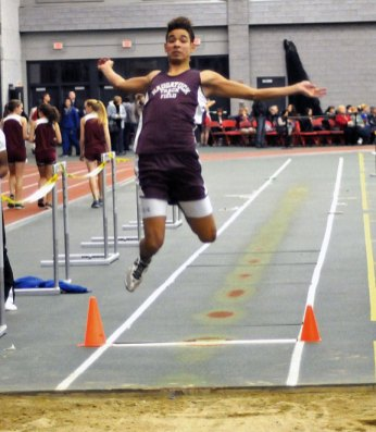 Naugatuck High School's Isaque Monterio competes in the long jump during the NVL indoor track championship. The Naugatuck boys won the meet. –FILE PHOTO